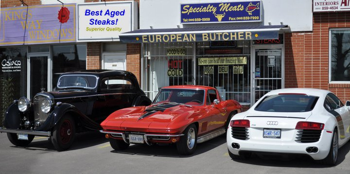 Specialty Meats Plus store front and cars